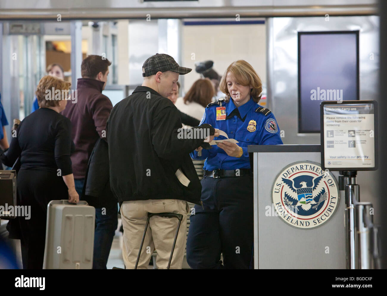 Security officer checks identification of passenger at Detroit Metro Airport - Stock Image