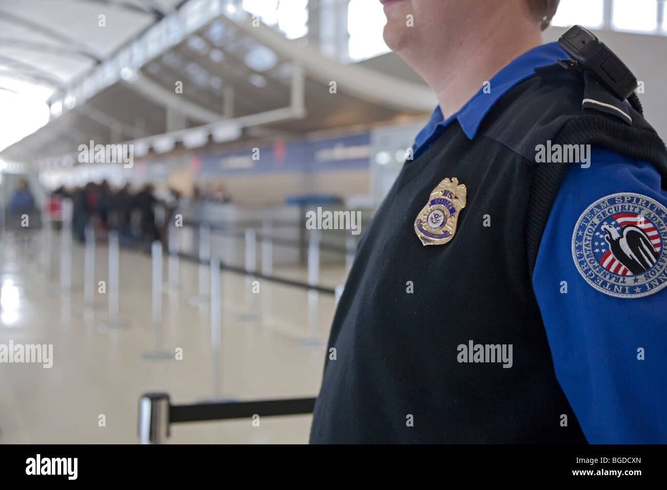 Romulus, Michigan - A security officer watches passengers arriving at Detroit Metropolitan Airport. - Stock Image