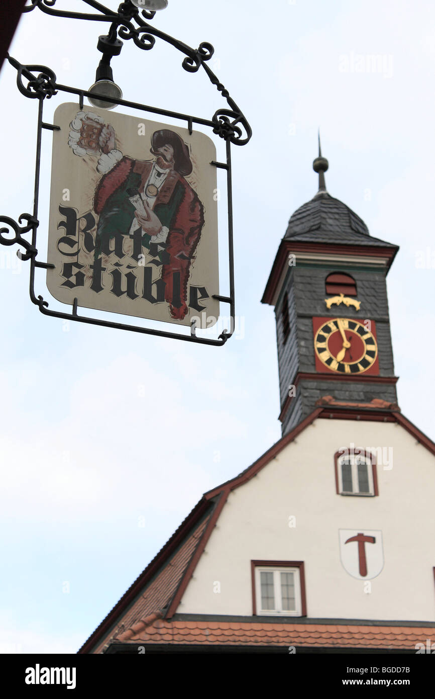 Ratsstueble inn sign in front of the clock and bell tower of the Old Town Hall, Neuenstein, Hohenlohe, Baden-Wuerttemberg, - Stock Image