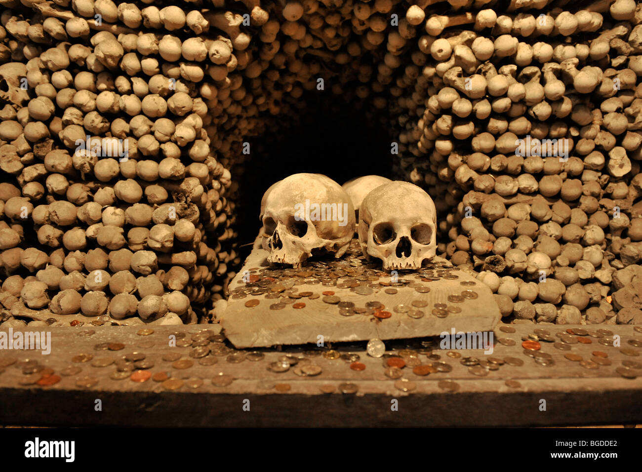 skulls bones and coins at the ossuary,kostnice, kutna hora, czech republic - Stock Image