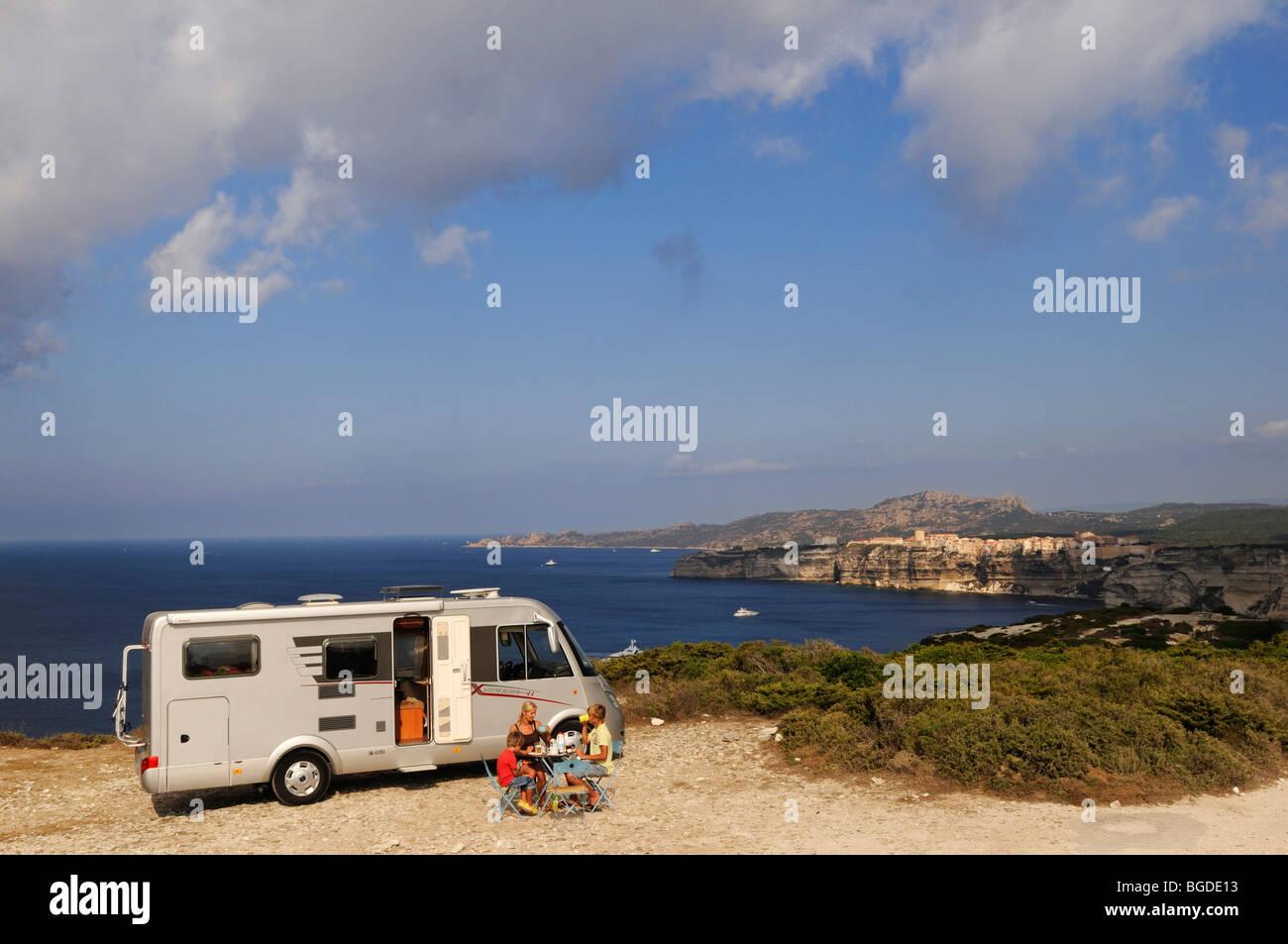 Mother and child in front of a camper, Capo Pertusato, Bonifacio, Corsica, France, Europe - Stock Image