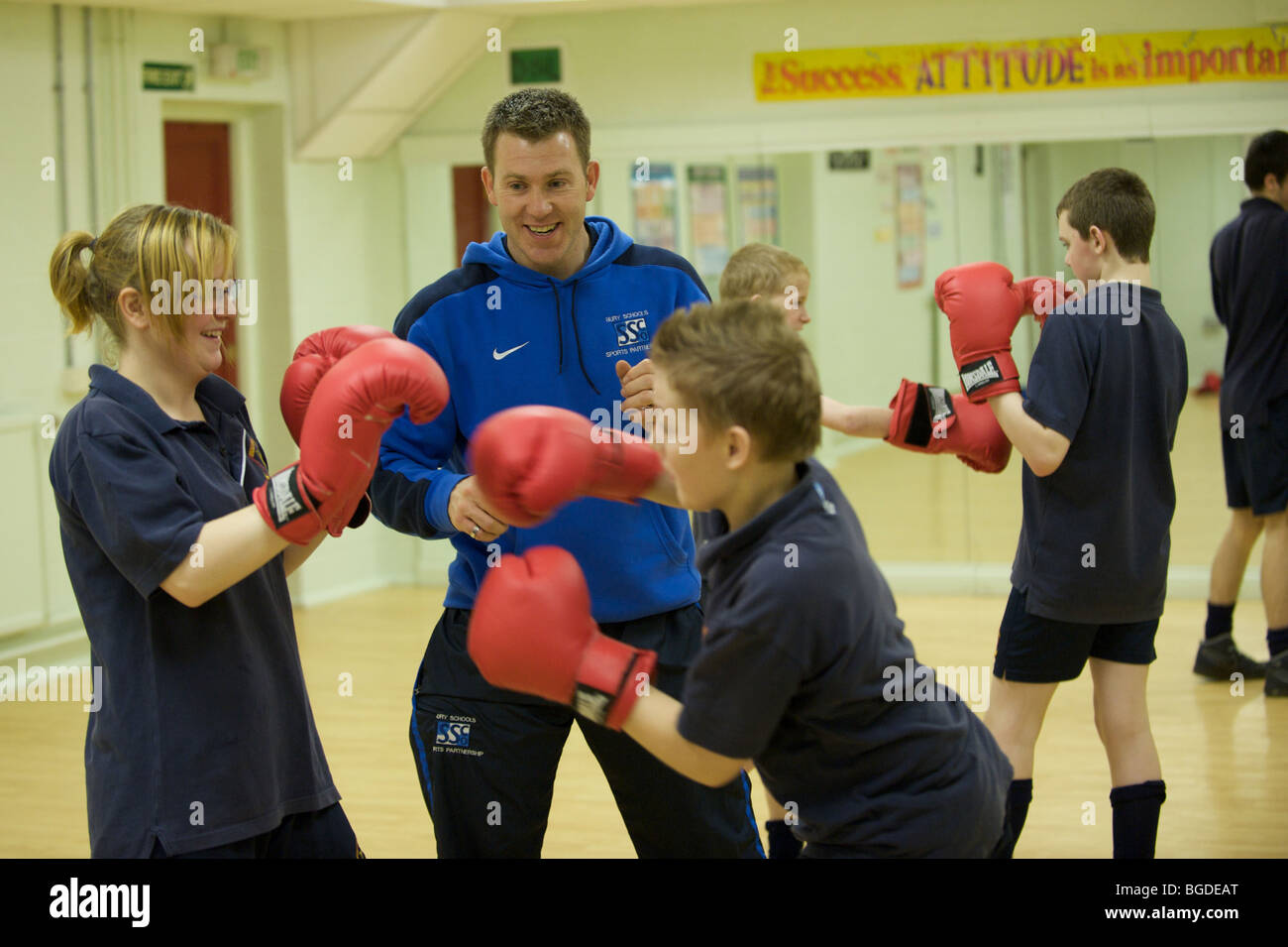pupils at Broadoak Sports College a secondary school in BURY, near Manchester boxing in the gym as part of their - Stock Image