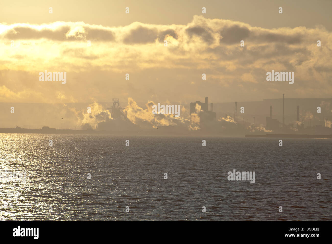 A view across Hartlepool Bay towards the North Yorks Moors and the corus steelworks at Redcar - Stock Image