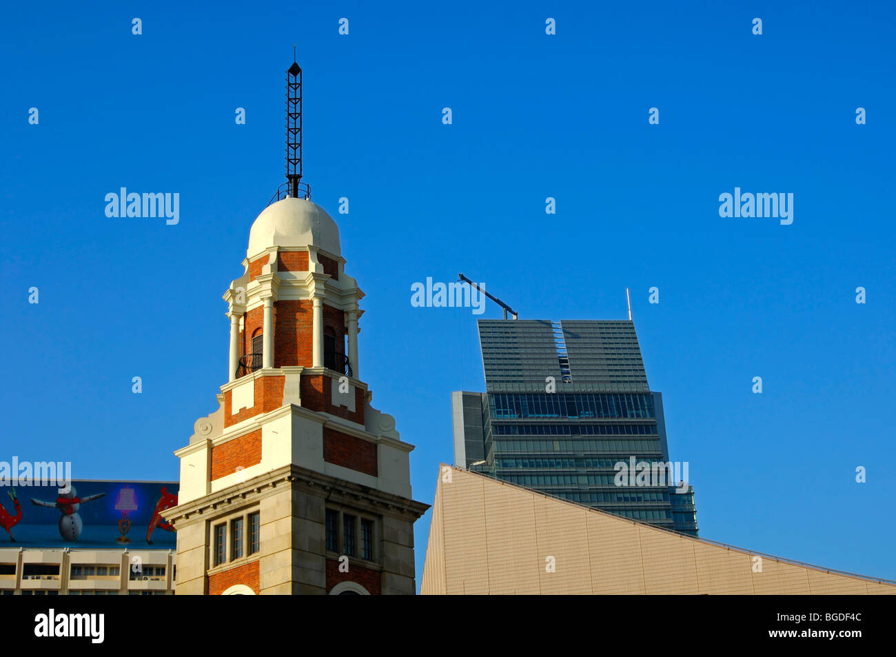 Spire of the old clock tower and a modern high-rise in the rear, Kowloon, Hong Kong, China, Asia - Stock Image