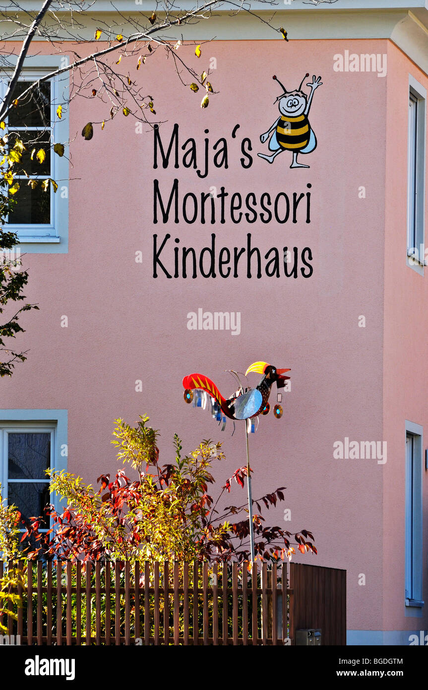 Maja's Montessori Kinderhaus nursery, facade with modern scarecrow, Munich, Bavaria, Germany, Europe - Stock Image