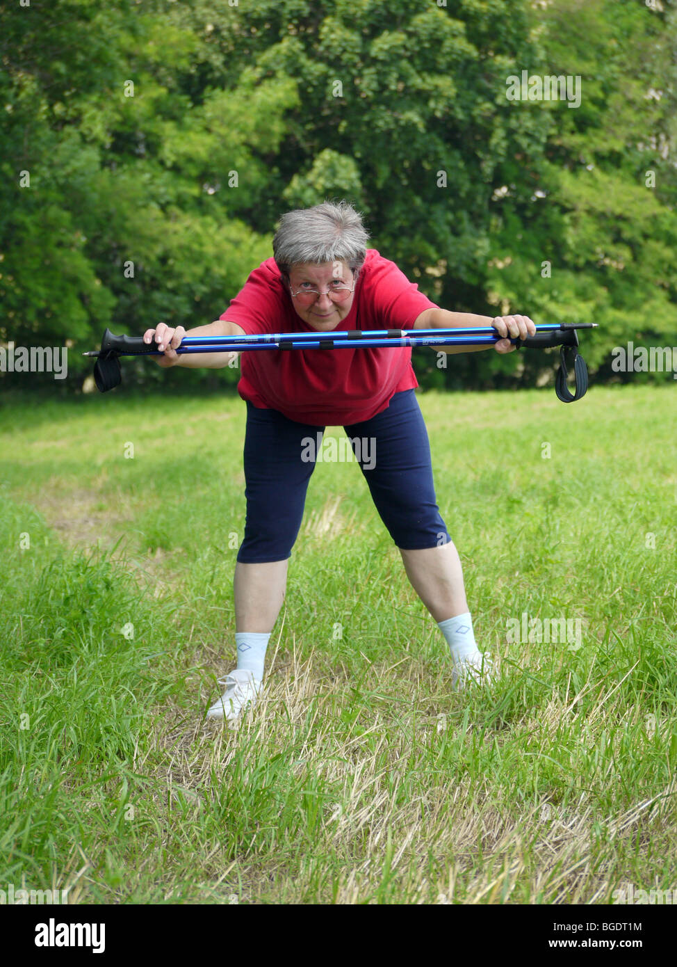 Senior woman doing a series of warm-up exercises with