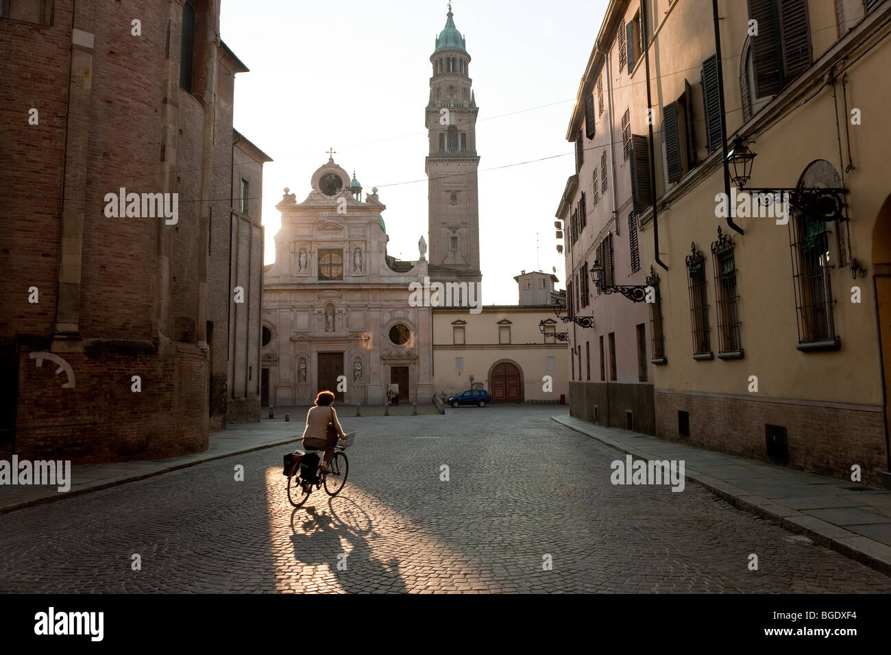 Tower of the Church of Saint John the Evangelist, Duomo (cathedral) on left Parma, Emilia Romagna, Italy - Stock Image