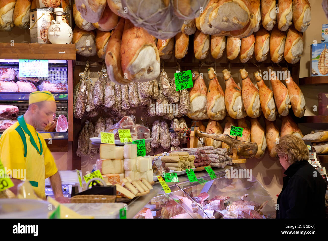 A selection of Parma hams, cheeses in a deli in Parma, Emilia Romagna, Italy - Stock Image