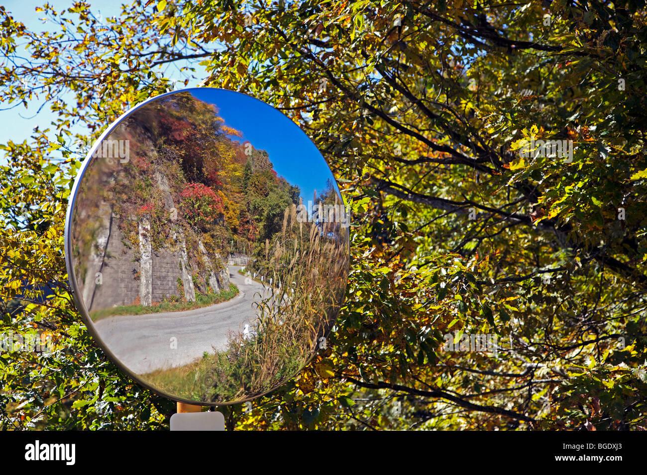 Mirror on road bend, Nagano, Japan - Stock Image