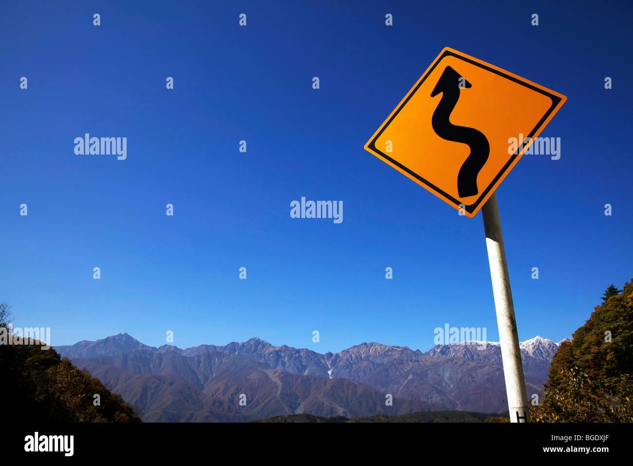 Winding road sign, near Hakuba, Nagano Prefecture, Japan - Stock Image