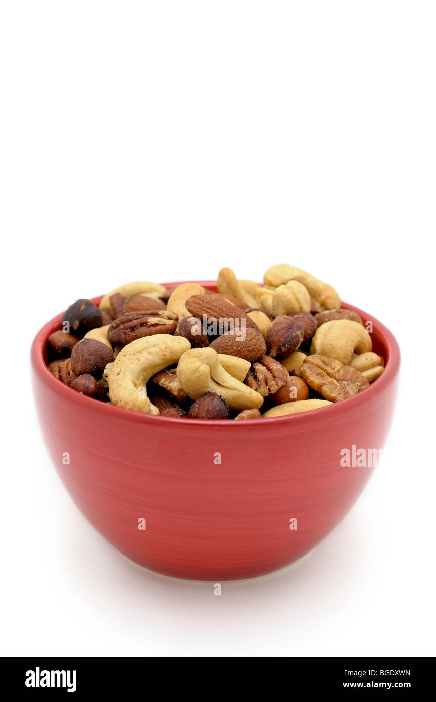 Bowl with mixed salted Nuts - Stock Image