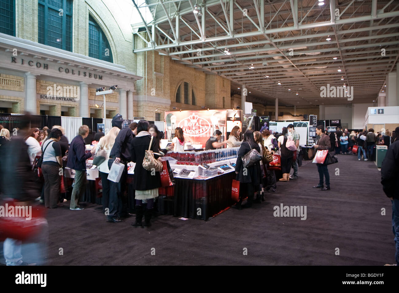 woman cosmetic makeup trade show consumer shopping - Stock Image