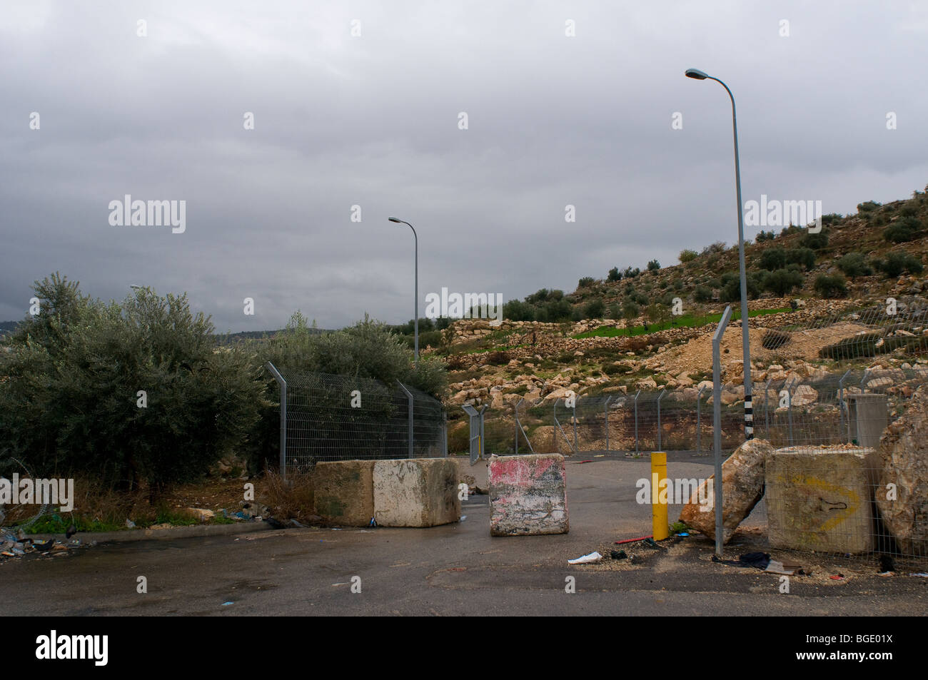 Physical obstacles between a road leading to a Palestinian village and Route 443 near Jewish town of Modiin, Israel - Stock Image