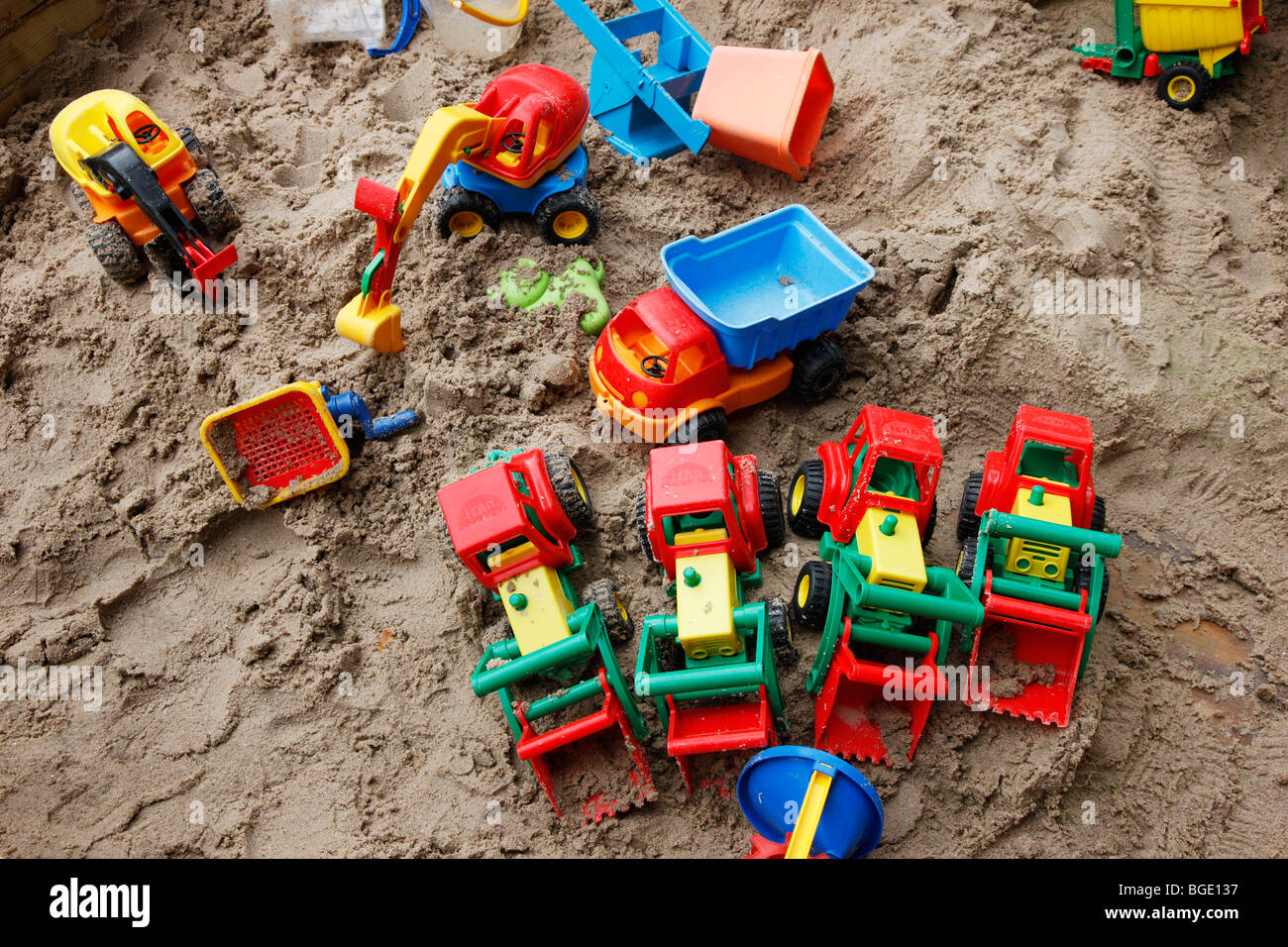 child's toys in a sandbox, outside. - Stock Image