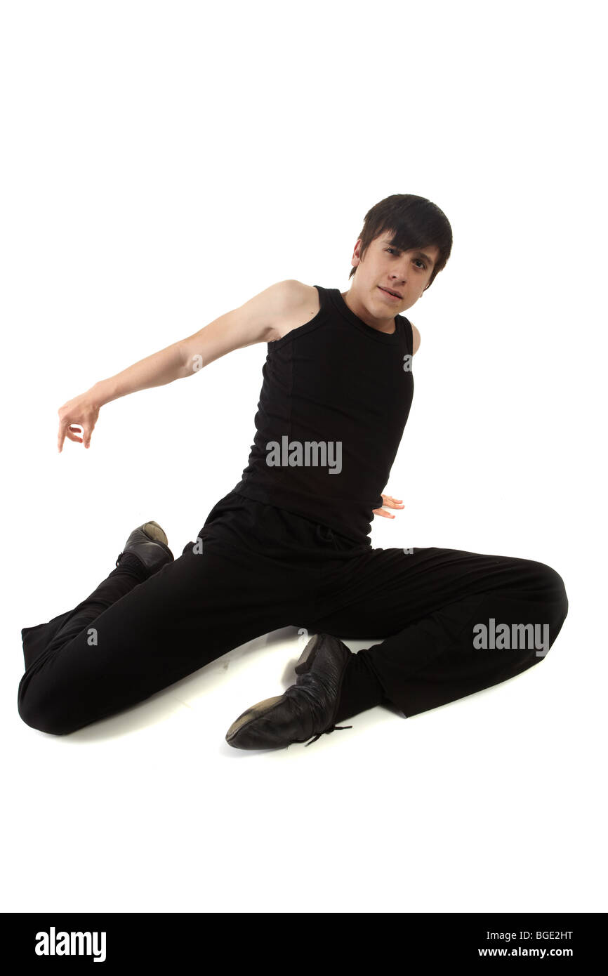 Young male Jazz dancer on a white background - Stock Image