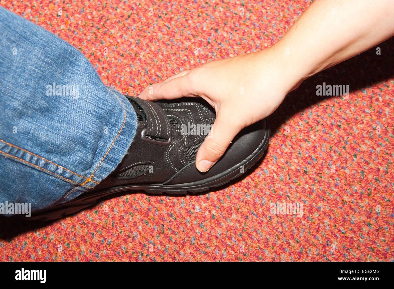 A shop assistant measures a childs feet
