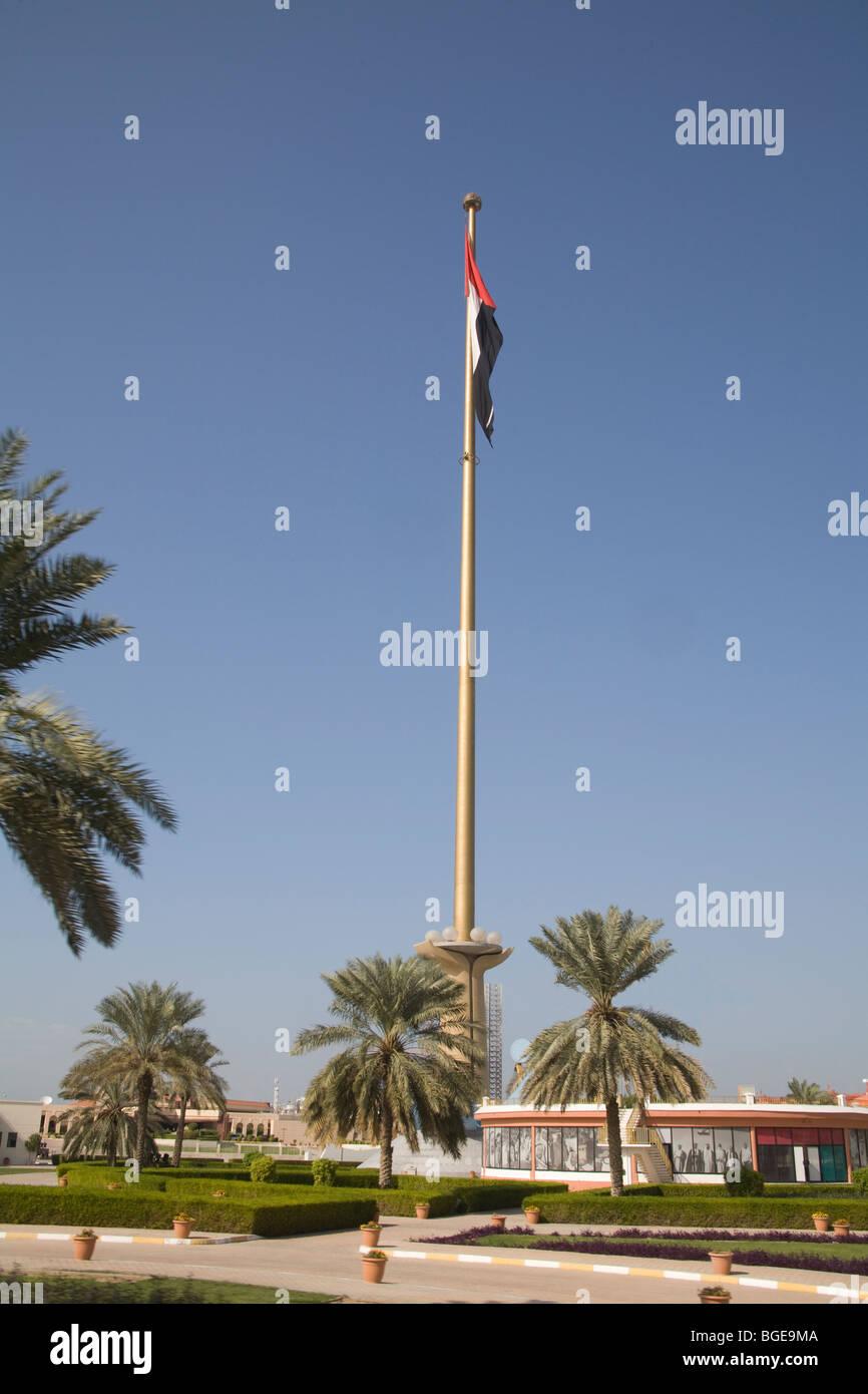 Dubai United Arab Emirates Tall flagpole with the UAE flag flying - Stock Image