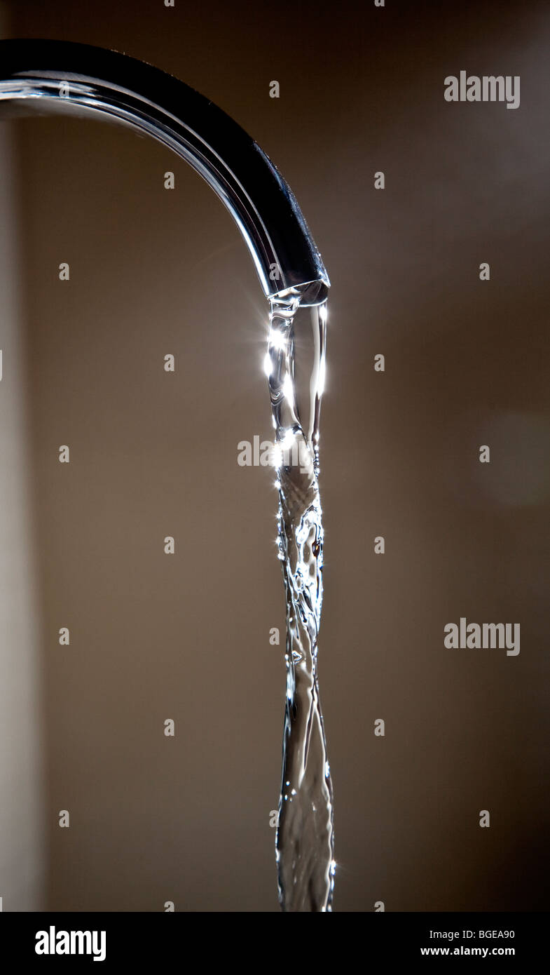 Water running from a domestic tap. - Stock Image