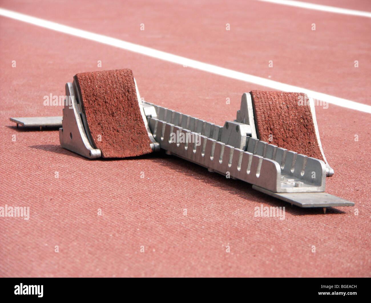 Shot of starting blocks on racing track - Stock Image