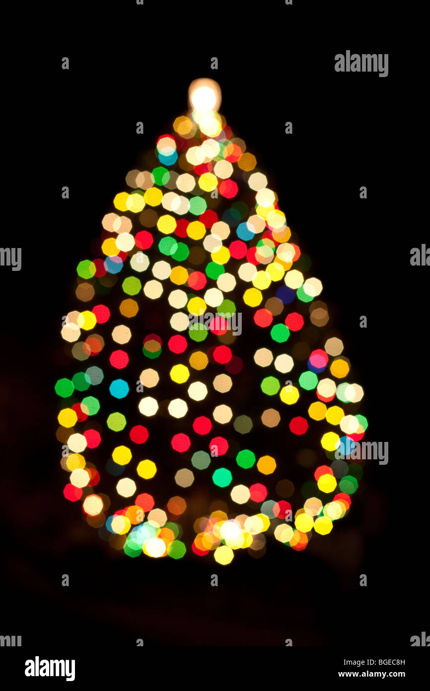 Out of focus colored lights on a christmas tree in Birmingham, England, UK - Stock Image