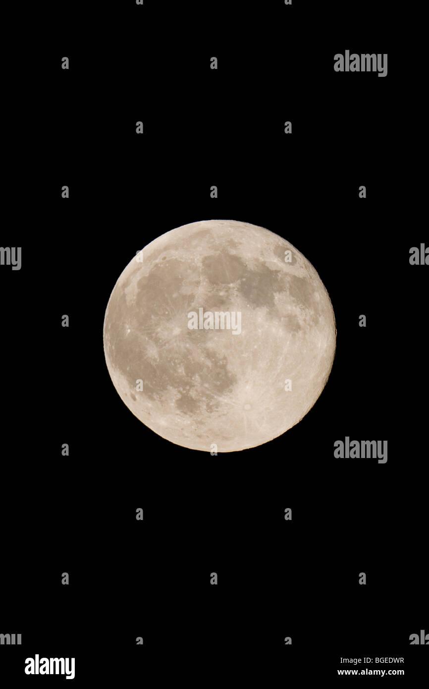full moon against dark sky at night Stock Photo