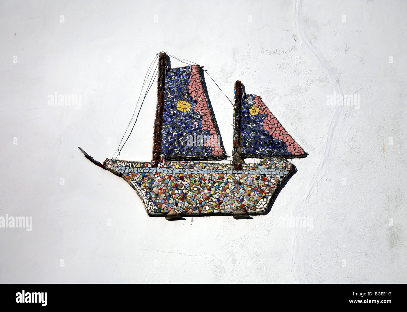 Boat on a wall in Minehead made of shells - Stock Image