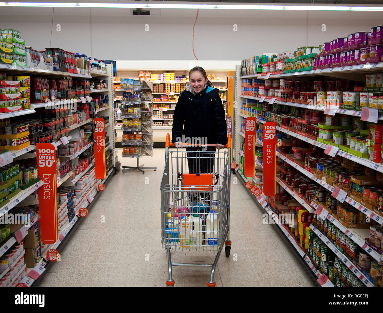 Young Girl in Supermarket - Stock Image