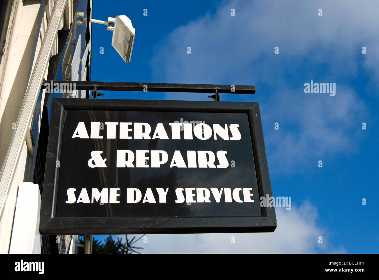 alterations and repairs sign outside a clothing shop in wimbledon, southwest london, england - Stock Image