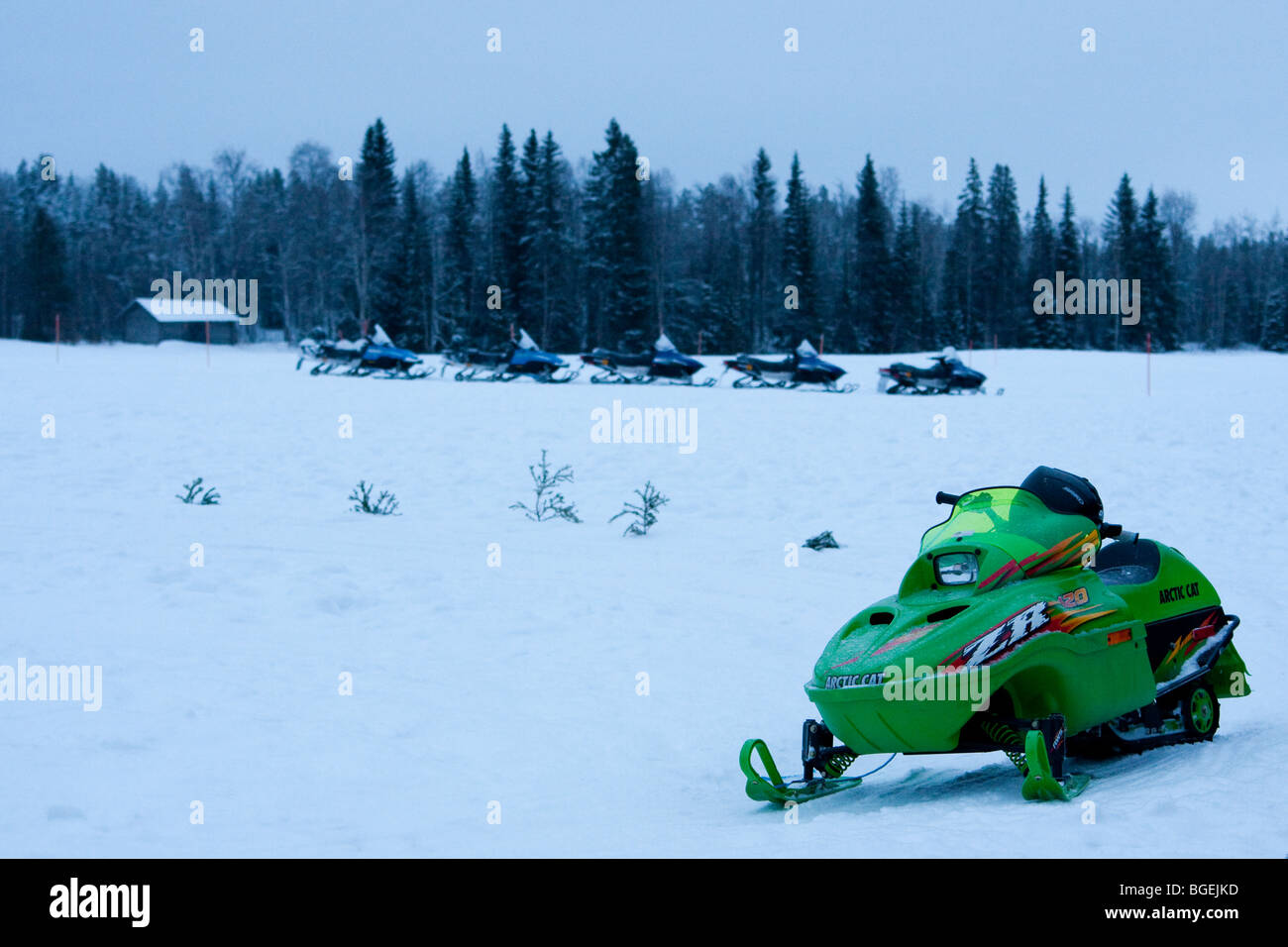 Snowmobiles in Lapland, in a snowy landscape - Stock Image