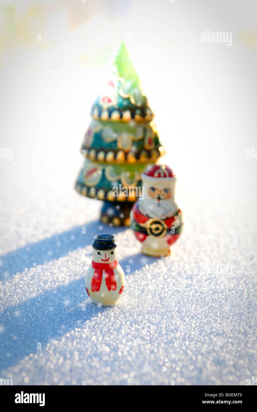 santa snowman christmas tree russian dolls in snow christmas decoration stock image