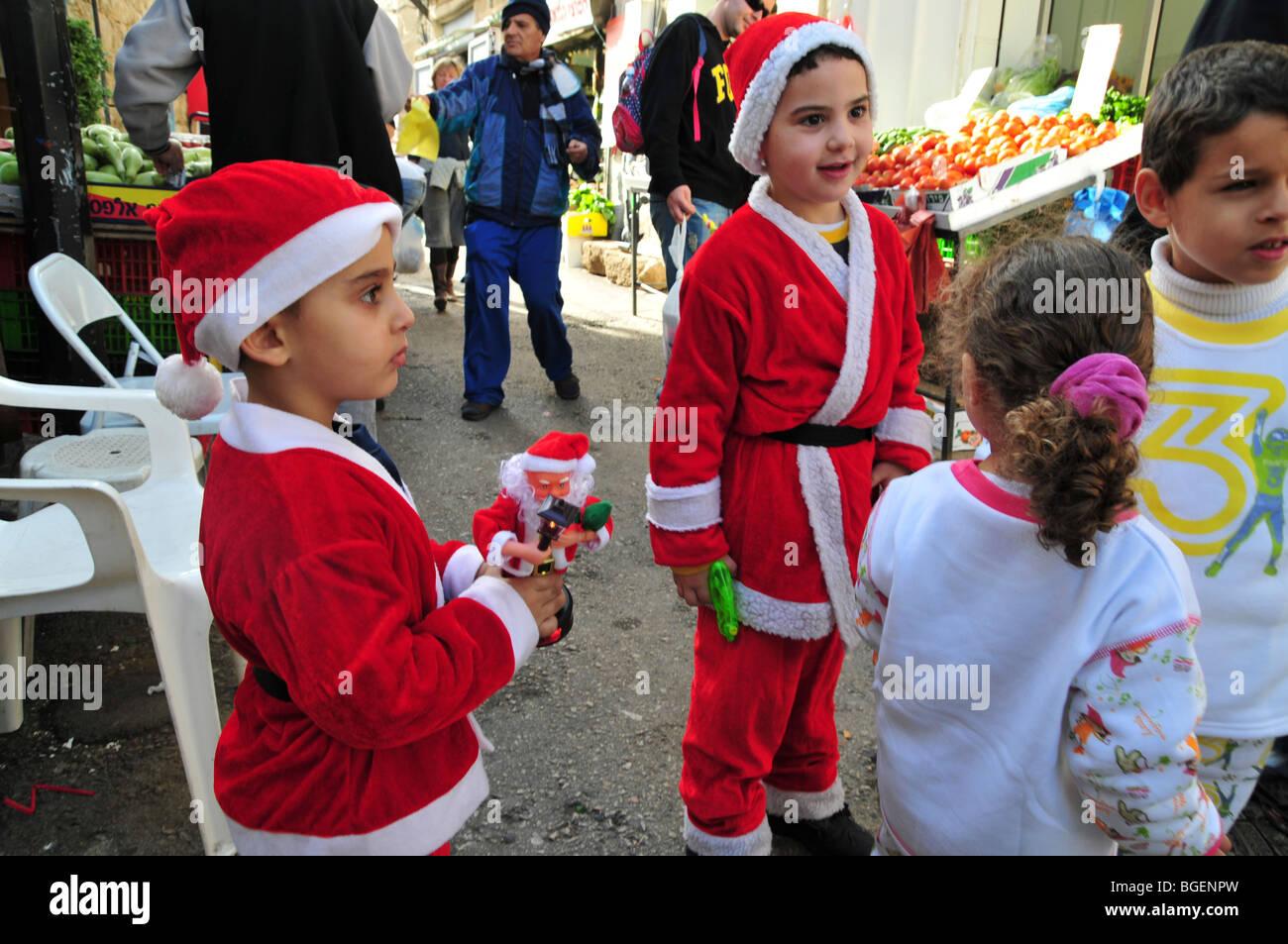 Israel, Haifa, Wadi Nisnas, the Holiday of holidays festival, Santa Claus in a parade - Stock Image