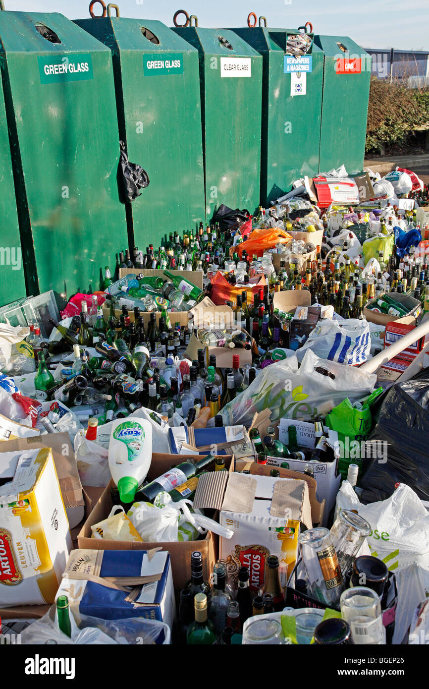 Overflowing bottle banks following Christmas festivities - Stock Image