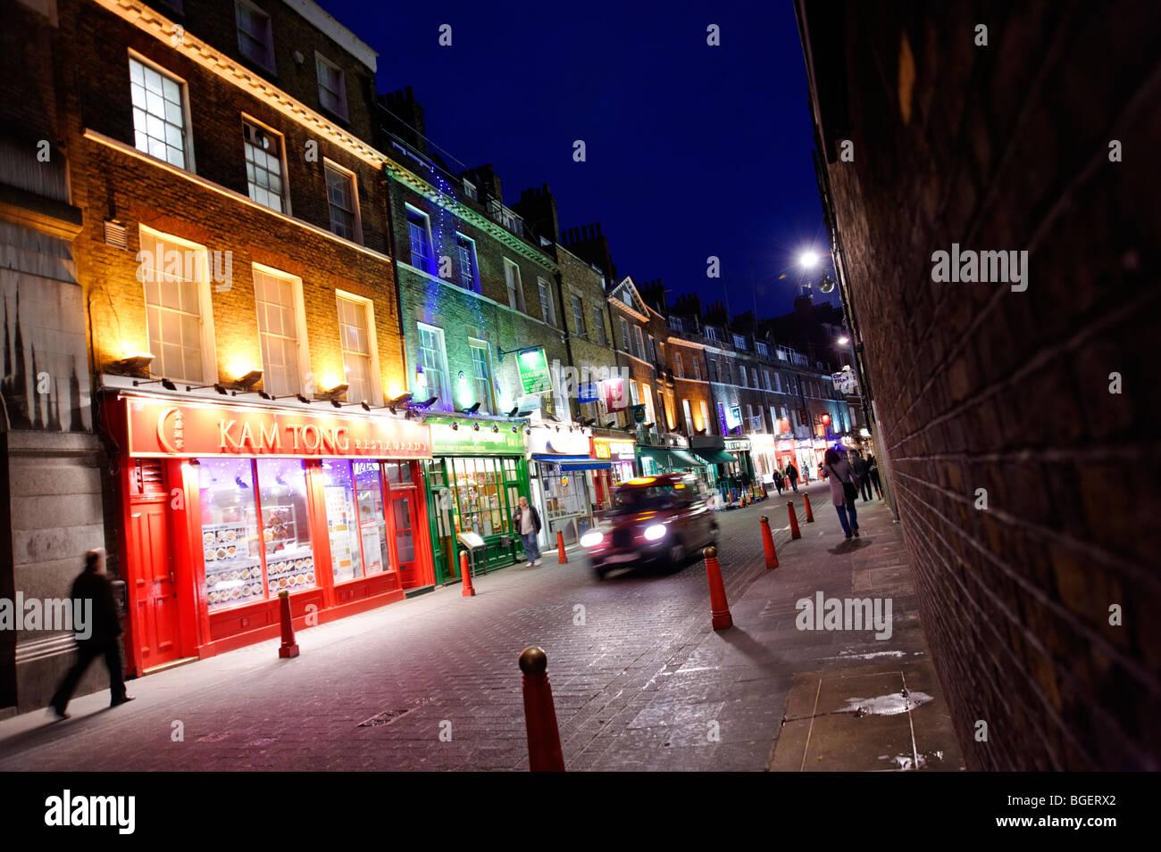 Row of Chinese restaurants in backstreet of Chinatown. Lisle Street. Soho. London. UK 2009 - Stock Image