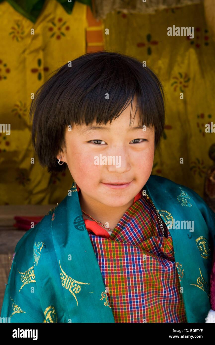 Young girl at Tsechu, or Festival, Ura, Bumthang Valley, BHUTAN - Stock Image