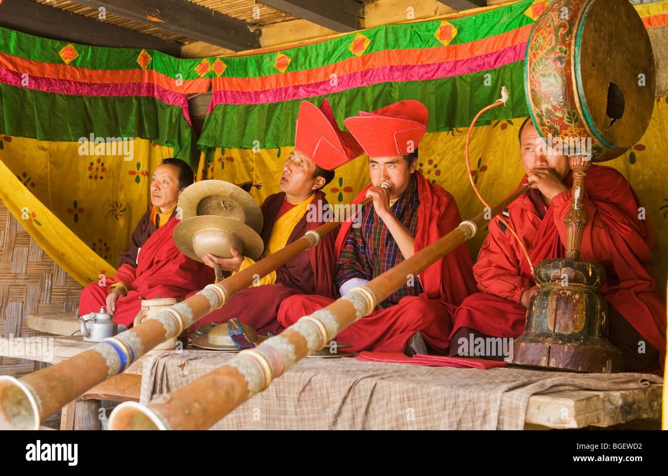 Monk Musicians play at Tsechu, or Festival, Ura, Bumthang Valley, BHUTAN - Stock Image