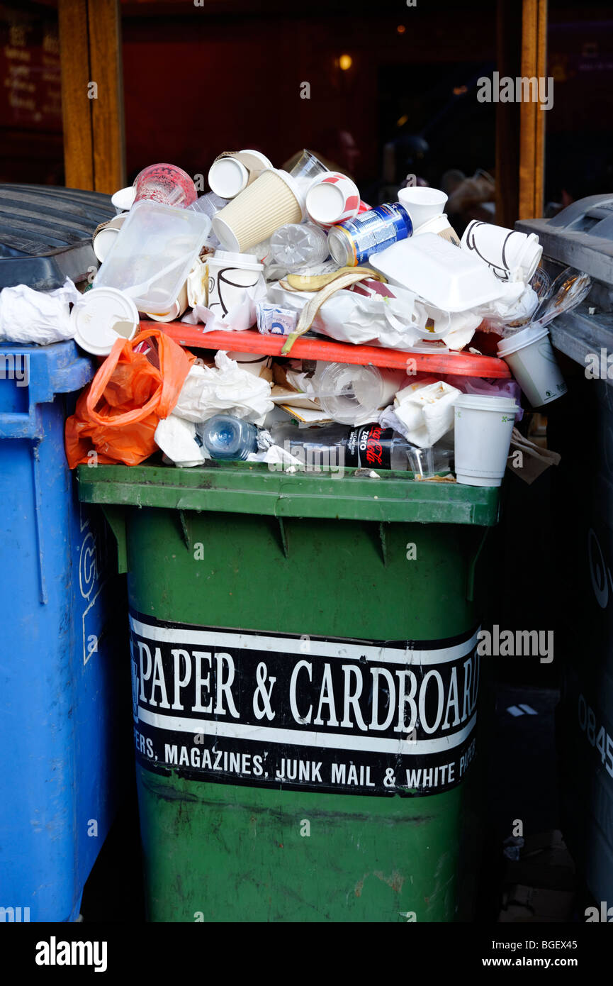 Overflowing recycling bin with mixed waste. London. Britain. UK - Stock Image
