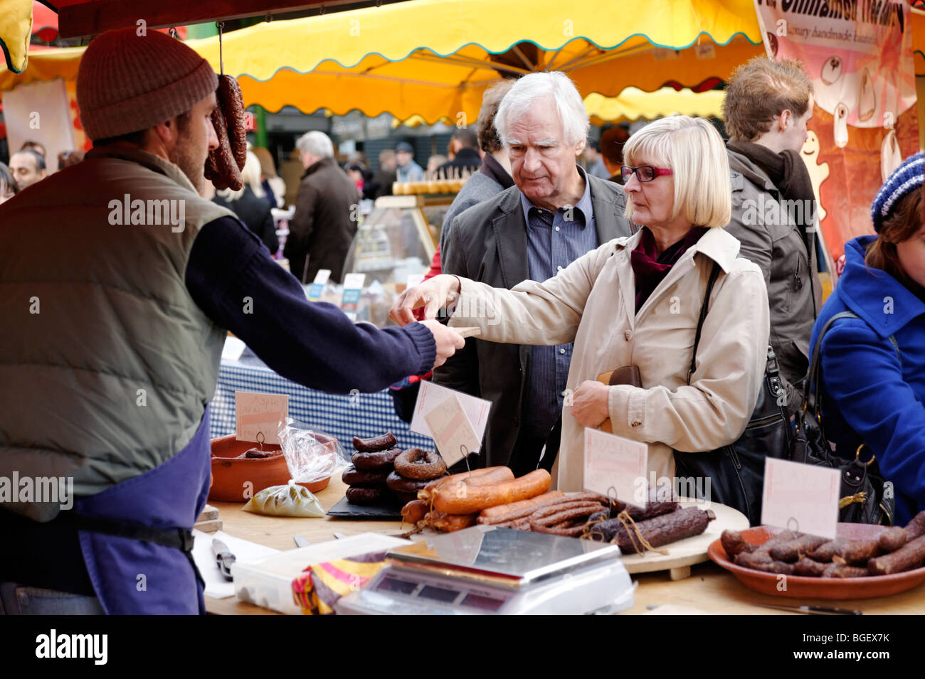 Middle class customers shopping at a Polish sausage stall. Borough Market. London. UK - Stock Image