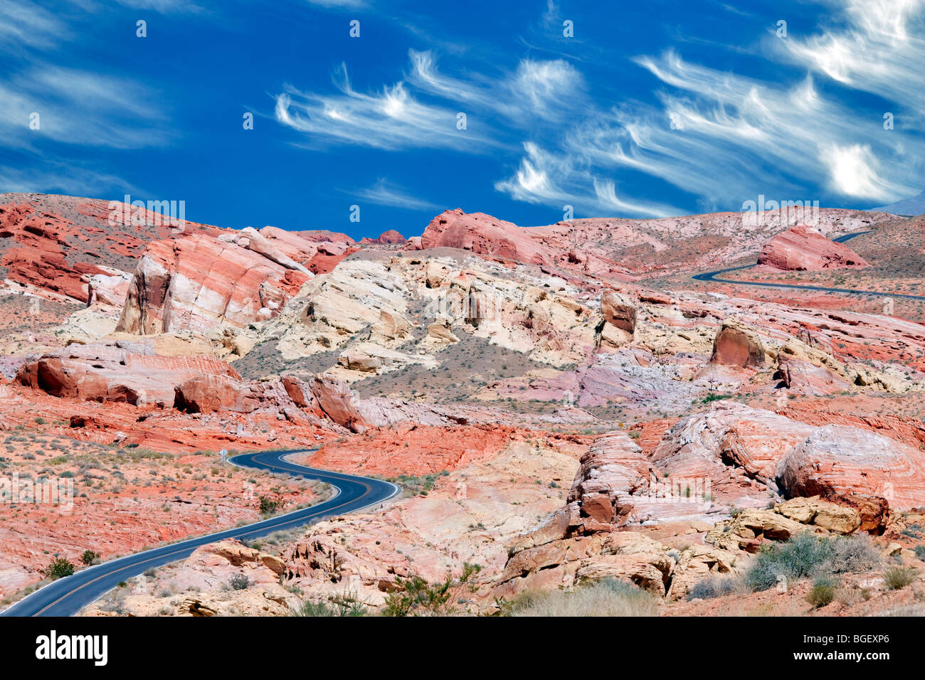 Road through Valley of Fire State Park, Nevada. Sky has been added. - Stock Image