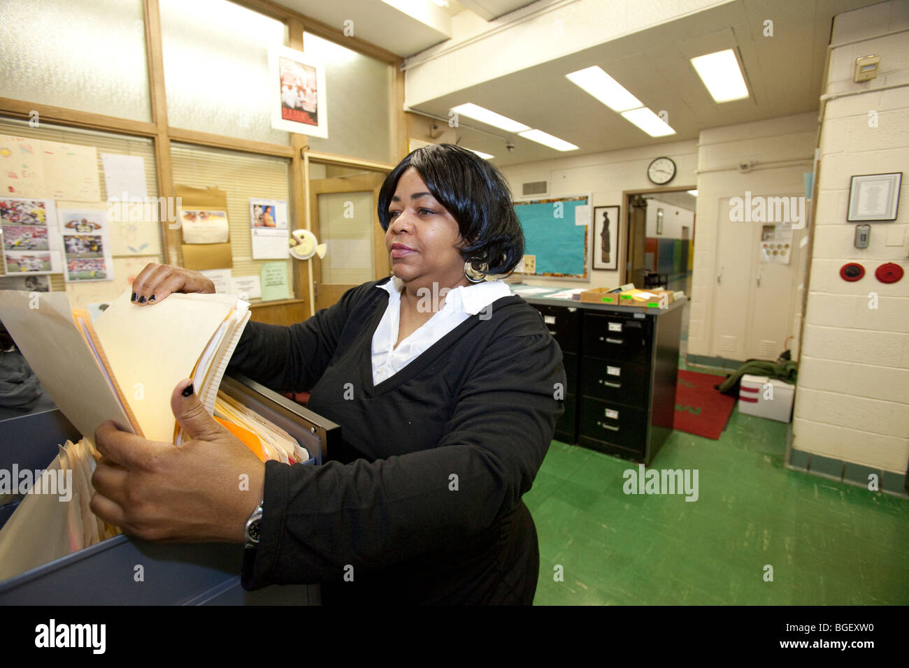 Detroit, Michigan - A Detroit Public Schools secretary on the job at Malcolm X Academy. - Stock Image