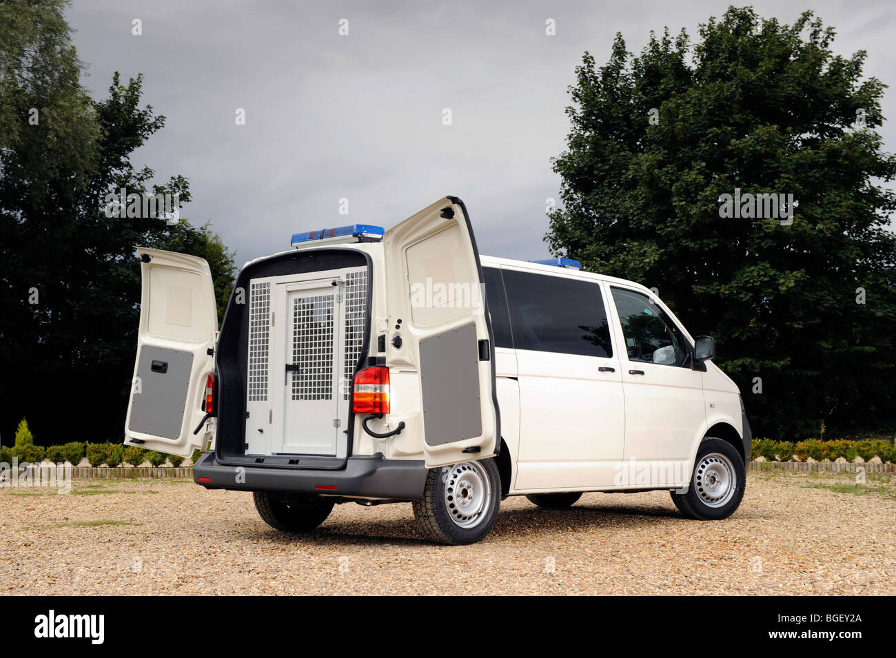 a rear view of a VW Volkswagen police van Vehicle showing the cell or cage - Stock Image