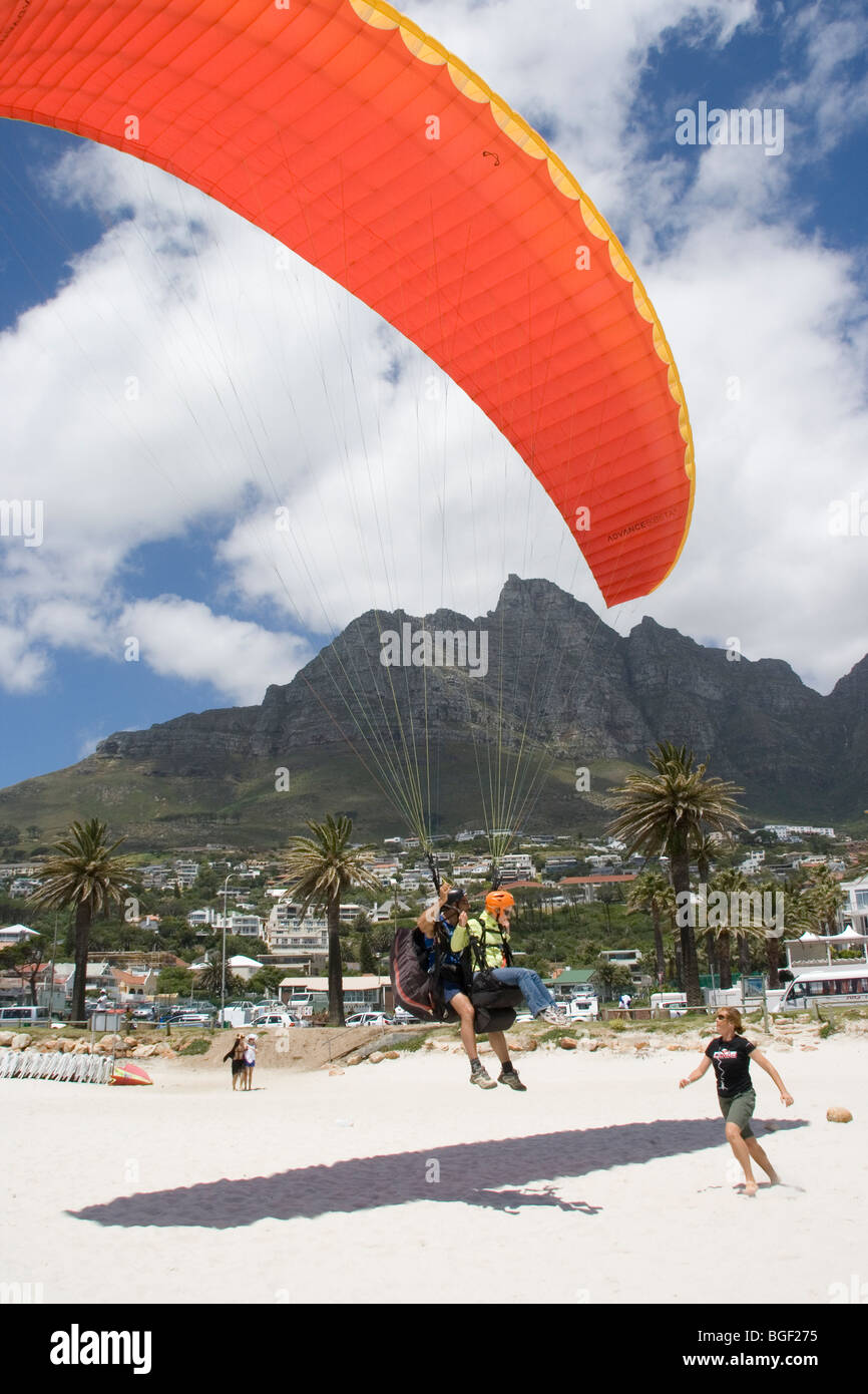 Paraglider landing at Camps Bay South Africa Stock Photo