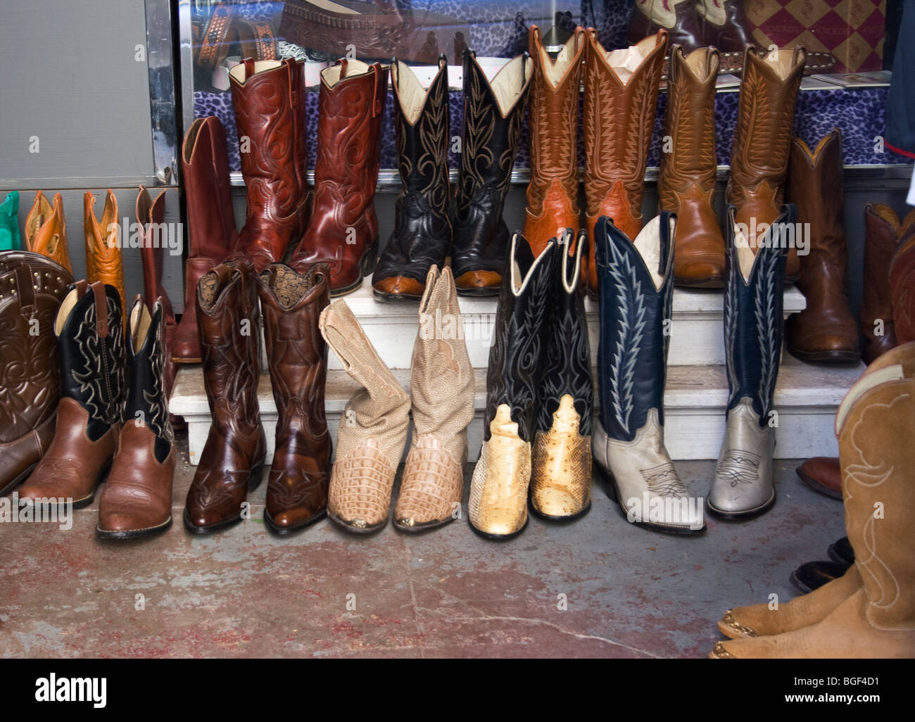 2308104b133 A variety of cowboy boots for sale in a New Orleans shoe store. - Stock
