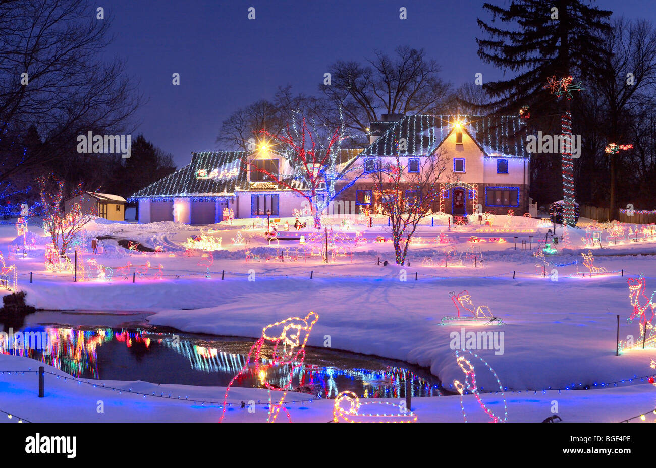 christmas lights on house with snow at night philadelphia usa