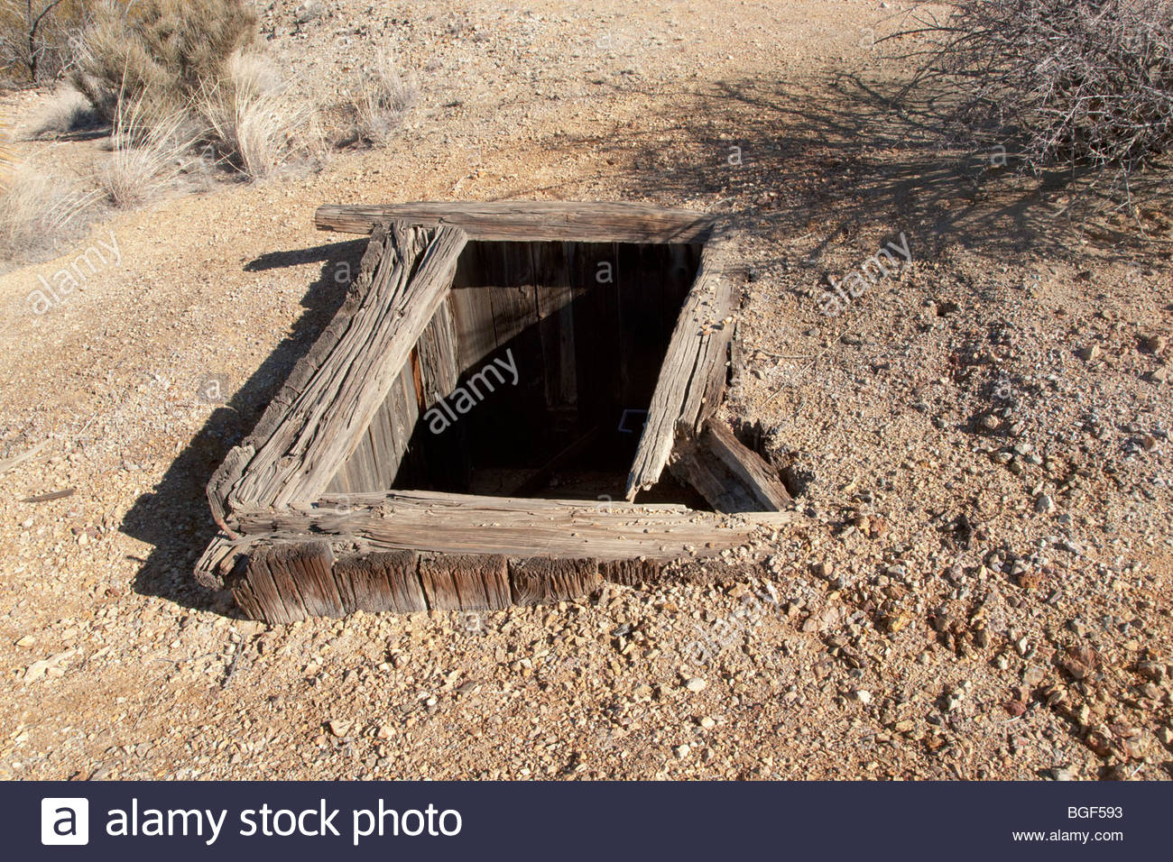 Abandoned unguarded mine shaft rotten timbers 'New Mexico' - Stock Image