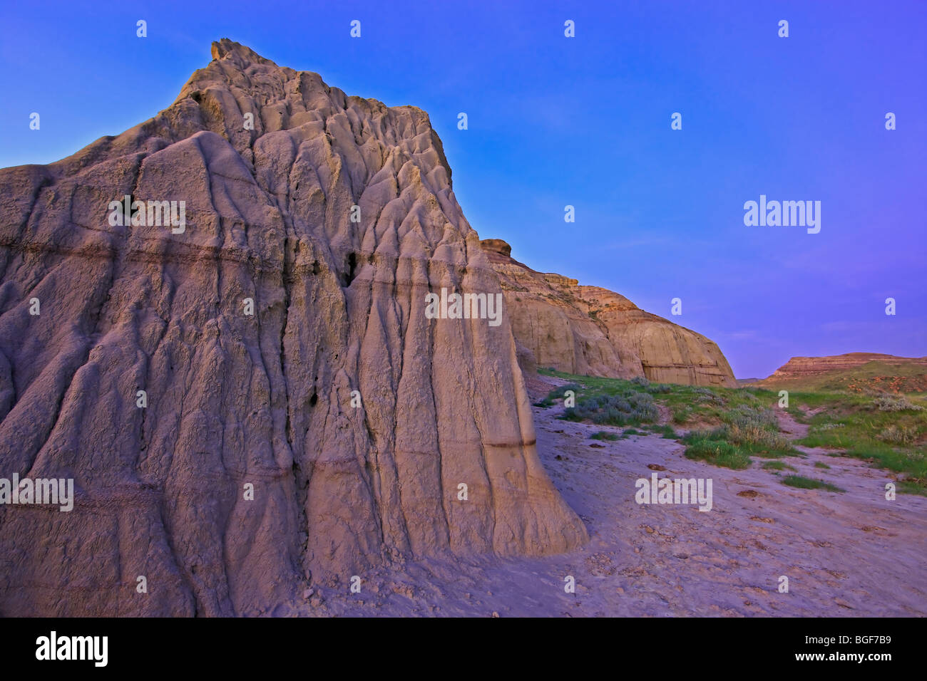 Formations of Castle Butte during dusk in Big Muddy Badlands, Southern Saskatchewan, Canada. - Stock Image