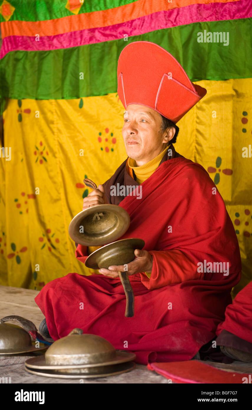 Monk Musician plays at Tsechu, or Festival, Ura, Bumthang Valley, BHUTAN - Stock Image