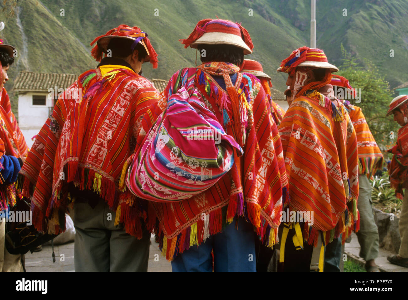 Peruvian porters on the Inca trail wearing woollen ponchos scarves or shawls, wait to guide tourists along the route. - Stock Image