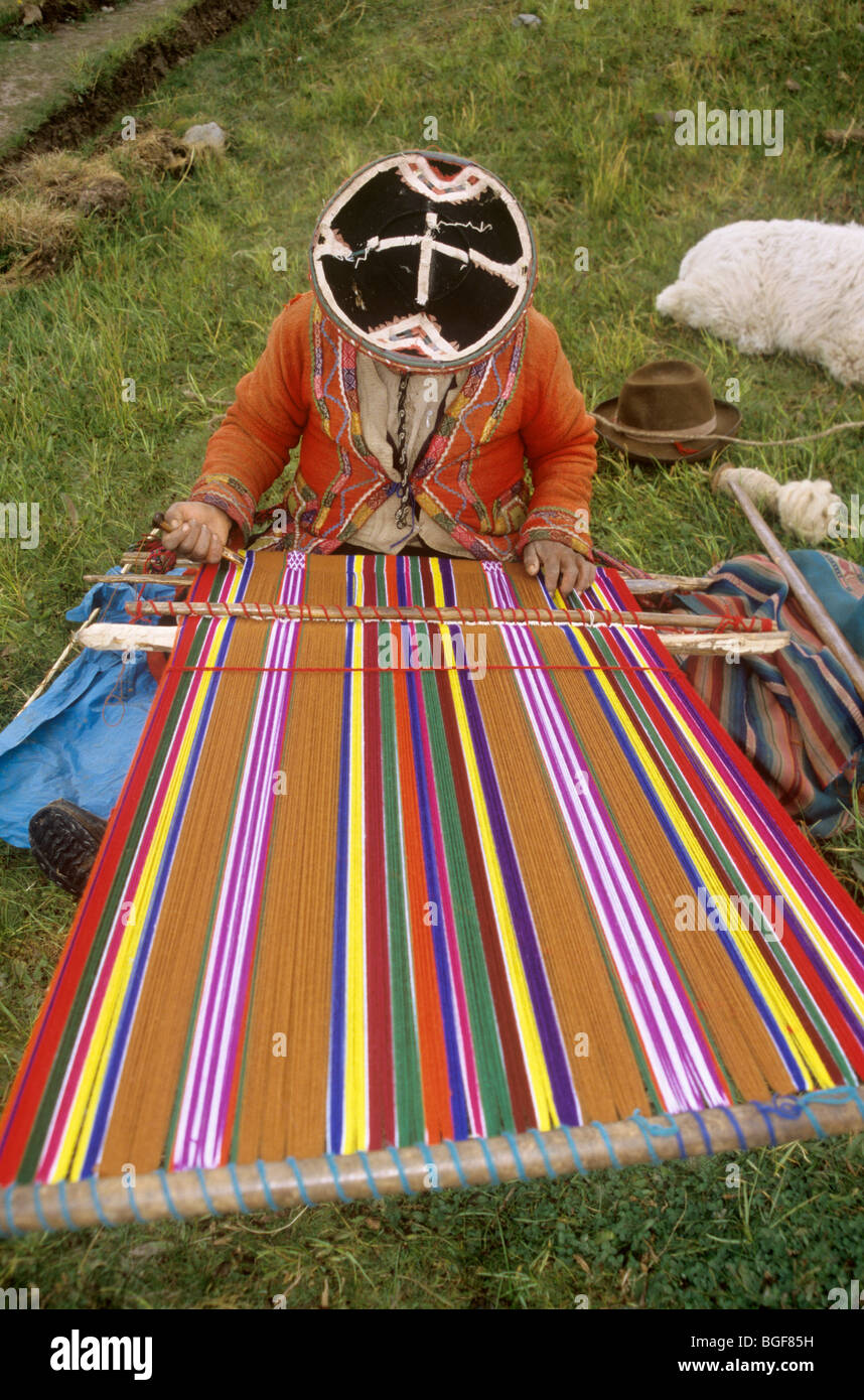 Peruvian woman on loom weaving a wool scarf or shawl, for