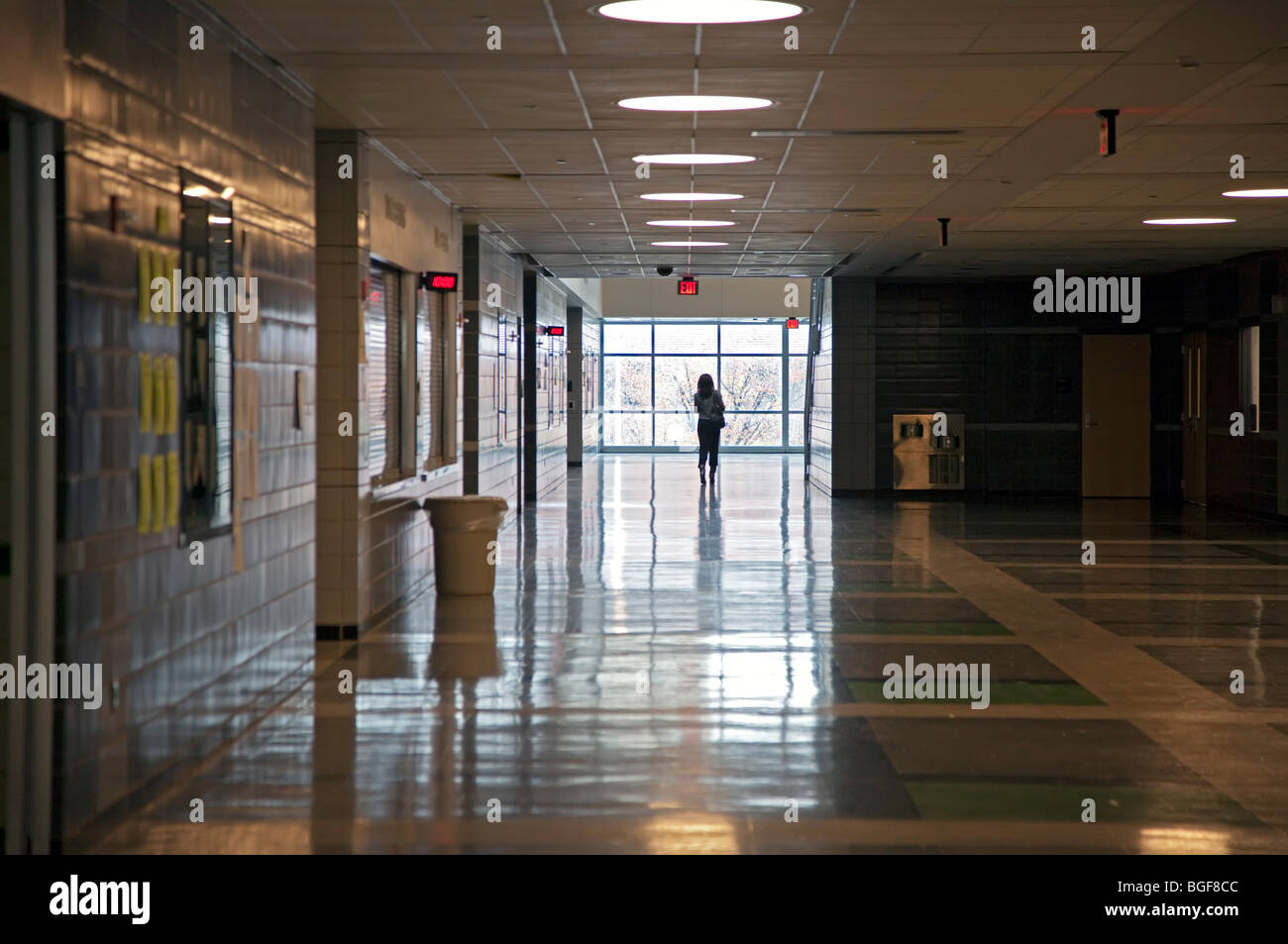 Detroit, Michigan - A single teacher walks in a hallway at Cass Technical High School. - Stock Image