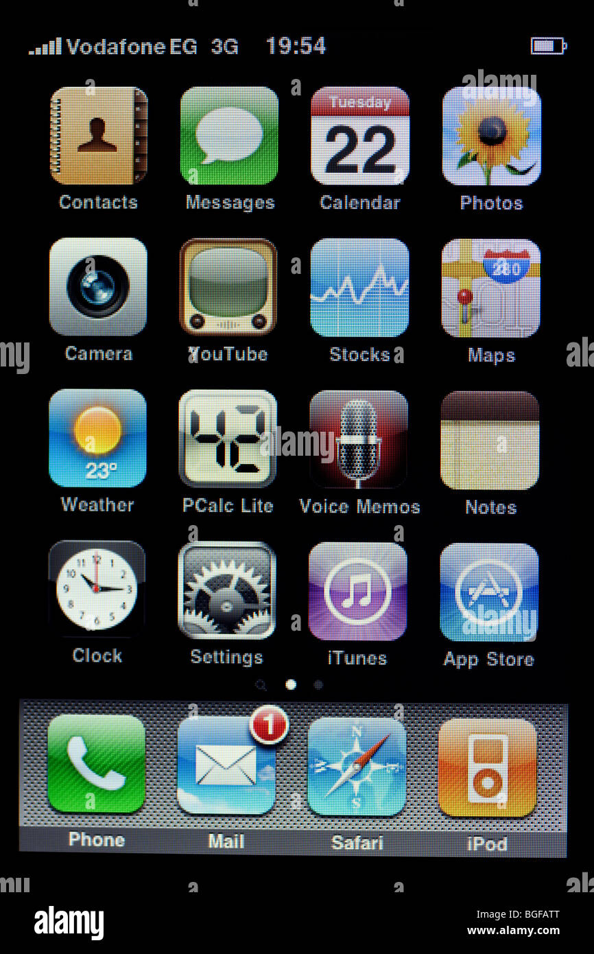 screen of Apple iPhone showing applications on home page with one new mail message - Stock Image